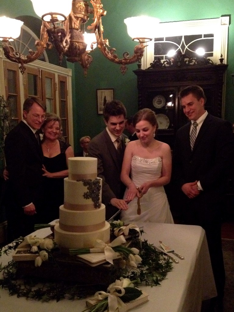 Justin and Kathryn cutting the cake NOLA   Justin and Kathryn's New Orleans Wedding