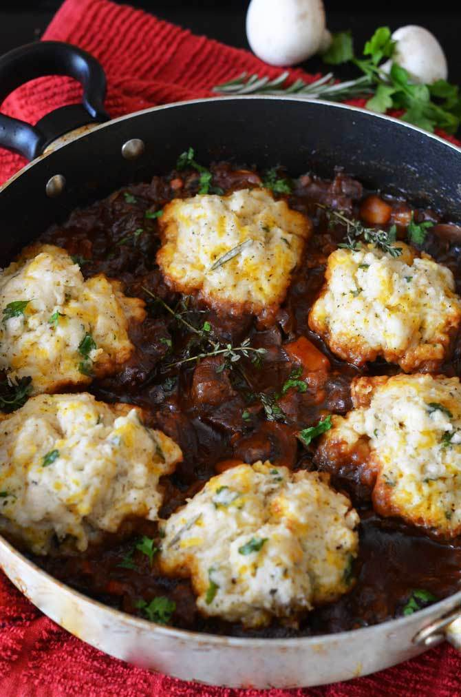 8 Savory Guinness Recipes - Guinness Beef Stew with Cheddar Herb Dumplings | Host the Toast