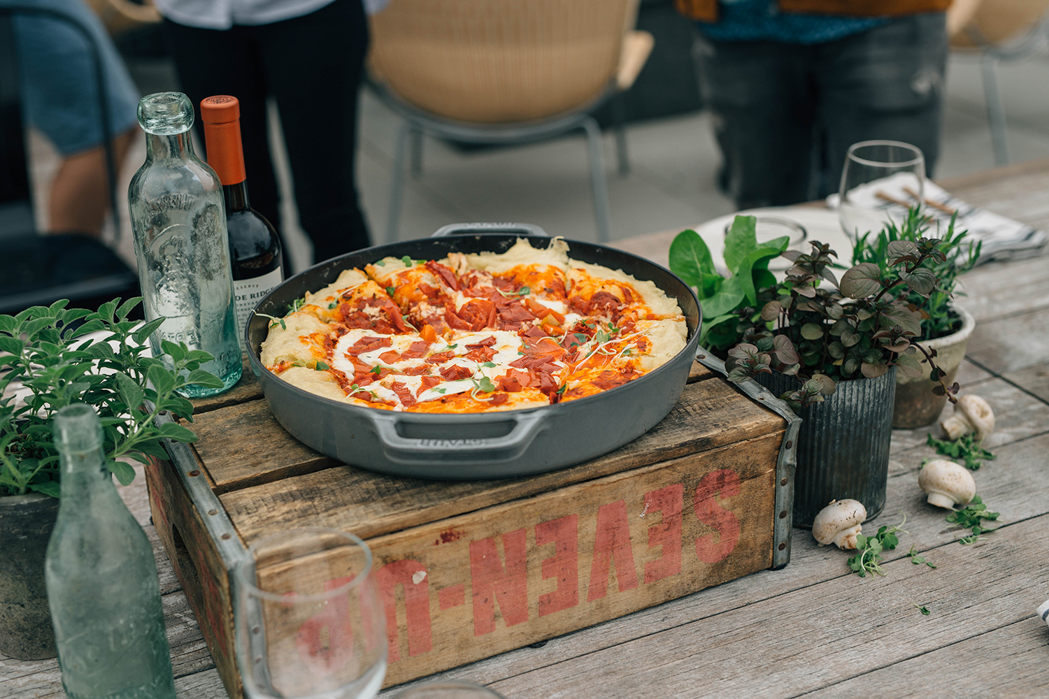 Pizza and Wine on a Rooftop in Seattle Deep Dish Pizza by Matt Broussard