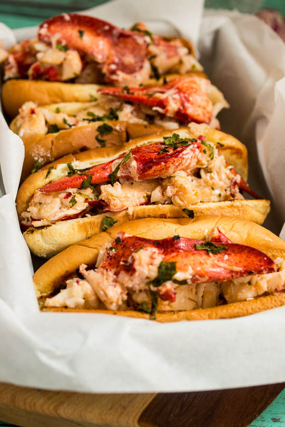 Lobster Rolls with Lemon Herb Butter   Girl In The Little Red Kitchen - Pinterest Picks - 8 Indulgent Seafood Recipes for Christmas Eve