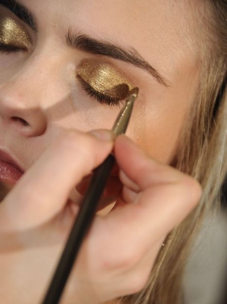 Cara Delevingne's golden eyes on Glitter Guide | Pinterest Picks - Sequins, Gold, Glitter