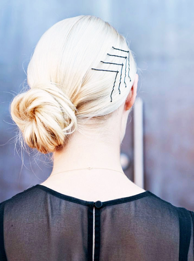 Embellished Low Bun: 6 Easy Labor Day Hairstyles—No Labor Required | Byrdie | 6 Easy Hairstyles to Try This Fall