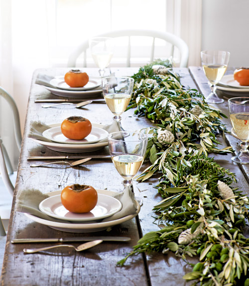 How to Make a Gorgeous Herb and Olive-Leaf Table Garland | Country Living | Simple Thanksgiving Table Setting Ideas