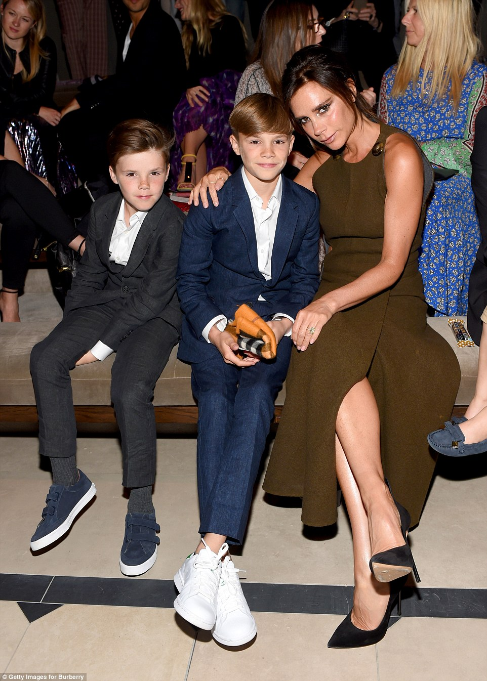 Beckham Family Front Row at Burberry | DailyMail | Stylish Celebrity Moms