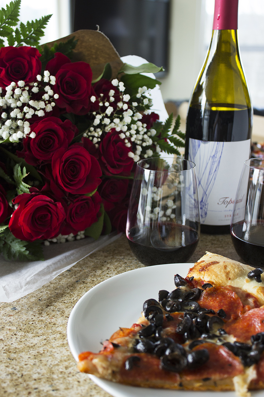 Whole Foods Whole Trade Double Dozen Red Roses, pizza, and wine Low Key Valentine's Day with Style and Cheek