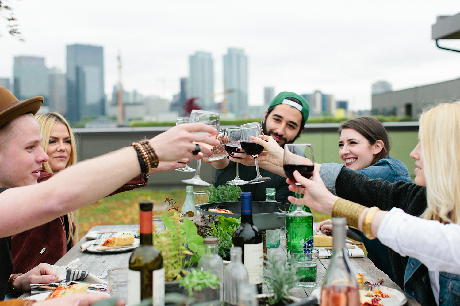 Pizza and Wine on a Rooftop in Seattle Canoe Ridge wine cheers