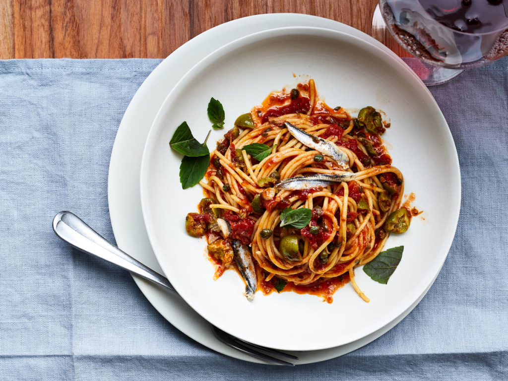 Spaghetti Puttanesca with Boquerones | Food & Wine - Photographer Victor Protasio, Food Stylist Chelsea Zimmer, Prop Stylist Thom Driver